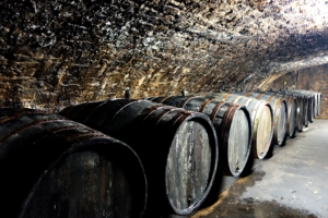centuries old oak barrels in the cellar of the Zilliken vineyard