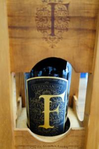 Ferdinand's Gold Cap Gin in a wooden lantern